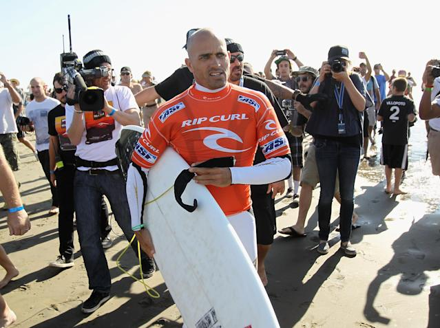 SAN FRANCISCO, CA - NOVEMBER 02: Kelly Slater is surrounded by fans as he walks to the water for heat 6 of round three of the Rip Curl Pro Search on November 2, 2011 in San Francisco, California. Slater won his heat to win his 11th ASP Men's World Title. (Photo by Ezra Shaw/Getty Images)