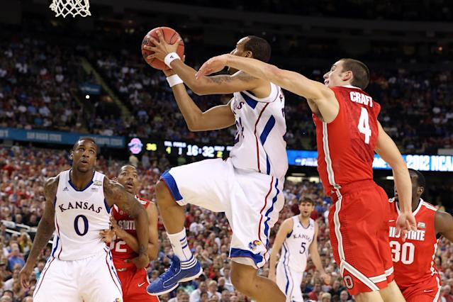 NEW ORLEANS, LA - MARCH 31: Travis Releford #24 of the Kansas Jayhawks goes up for a shot in front of Aaron Craft #4 of the Ohio State Buckeyes in the second half during the National Semifinal game of the 2012 NCAA Division I Men's Basketball Championship at the Mercedes-Benz Superdome on March 31, 2012 in New Orleans, Louisiana. (Photo by Jeff Gross/Getty Images)