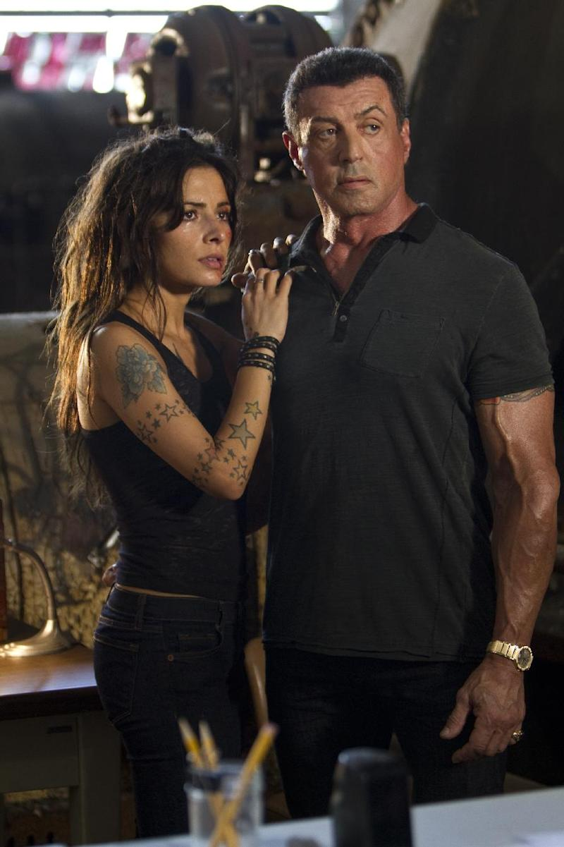 """This film image released by Warner Bros. Pictures shows Sarah Shahi, left, and Sylvester Stallone in a scene from """"Bullet to the Head."""" (AP Photo/Warner Bros. Pictures, Frank Masi)"""