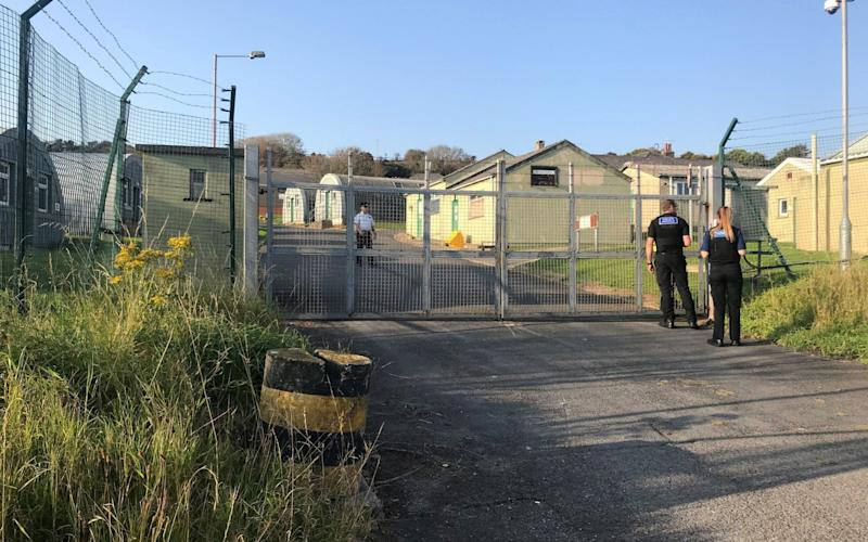 Outside a military barracks being used to house Channel migrants in the coastal village of Penally, near Tenby - Patrick Connellan/PA