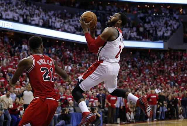 Washington Wizards guard John Wall (2) shoots over Chicago Bulls guard Jimmy Butler (21) in the second half of Game 3 of an opening-round NBA basketball playoff series on Friday, April 25, 2014, in Washington. The Bulls won 100-97. (AP Photo/Alex Brandon)