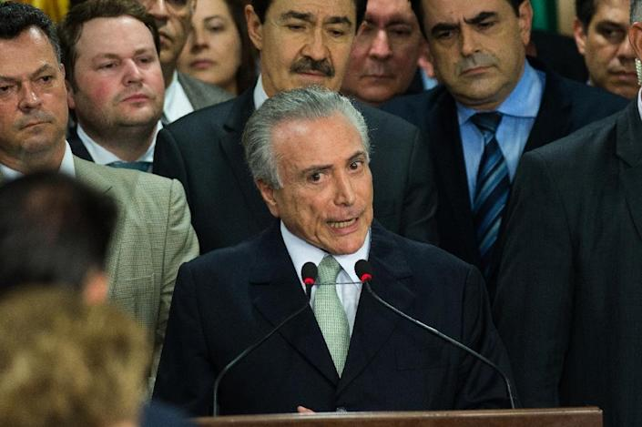 """Brazil's acting President Michel Temer (C) named a new all white male cabinet he said would restore """"credibility"""" after months of economic and political turmoil (AFP Photo/Andressa Anholete)"""