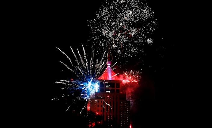 Fireworks explode over the UAP Old Mutual Tower. (Photo: Thomas Mukoya/Reuters)