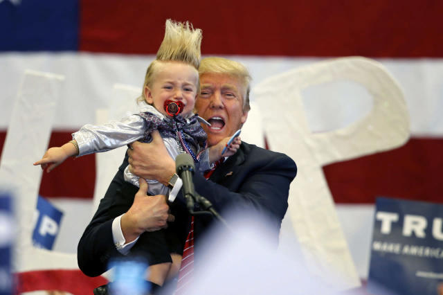 <p>Republican presidential candidate Donald Trump holds up a child he pulled from the crowd as he arrives to speak at a campaign rally in New Orleans, March 4, 2016. <i>(Photo: Gerald Herbert/AP)</i> </p>
