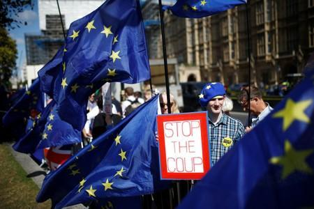 Anti-Brexit protesters stand outside the Houses of Parliament in London