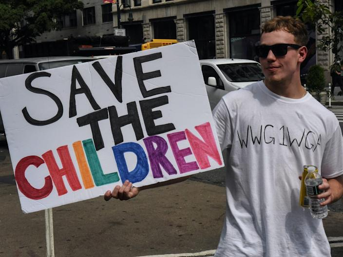 "A person wears a t-shirt with the abbreviation of QAnon's slogan, ""where we go one, we go all, while participating in a ""save the children"" march and rally in New York City on August 12, 2020. <p class=""copyright"">REUTERS/Stephanie Keith</p>"