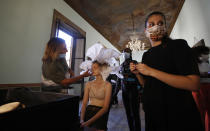 """A model gets her make-up done in the backstage at the """"We are Made in Italy - Black Lives Matter in Italian fashion Collection"""" event during the Milan's fashion week in Milan, Italy, Thursday, Sept. 17, 2020. (AP Photo/Antonio Calanni)"""