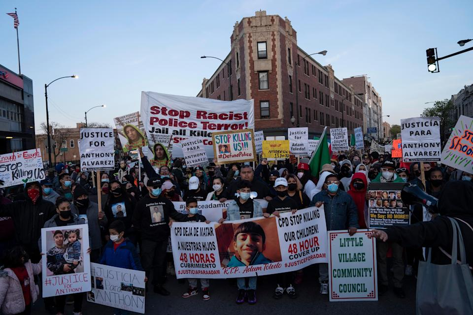Community members protest the the fatal shooting of 13-year-old Adam Toledo by a Chicago officer Friday April 15, 2021 in Chicago's Logan Square neighborhood.