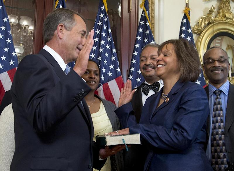 Rep. Robin Kelly, D-Ill., center, participates in a ceremonial swearing-in ceremony with House Speaker John Boehner of Ohio, Thursday, April 11, 2013, on Capitol Hill in Washington. Earlier Kelly was officially sworn in on the House floor. She takes over the seat held for 17 years by scandal-tarnished Jesse Jackson Jr.   (AP Photo/Manuel Balce Ceneta)