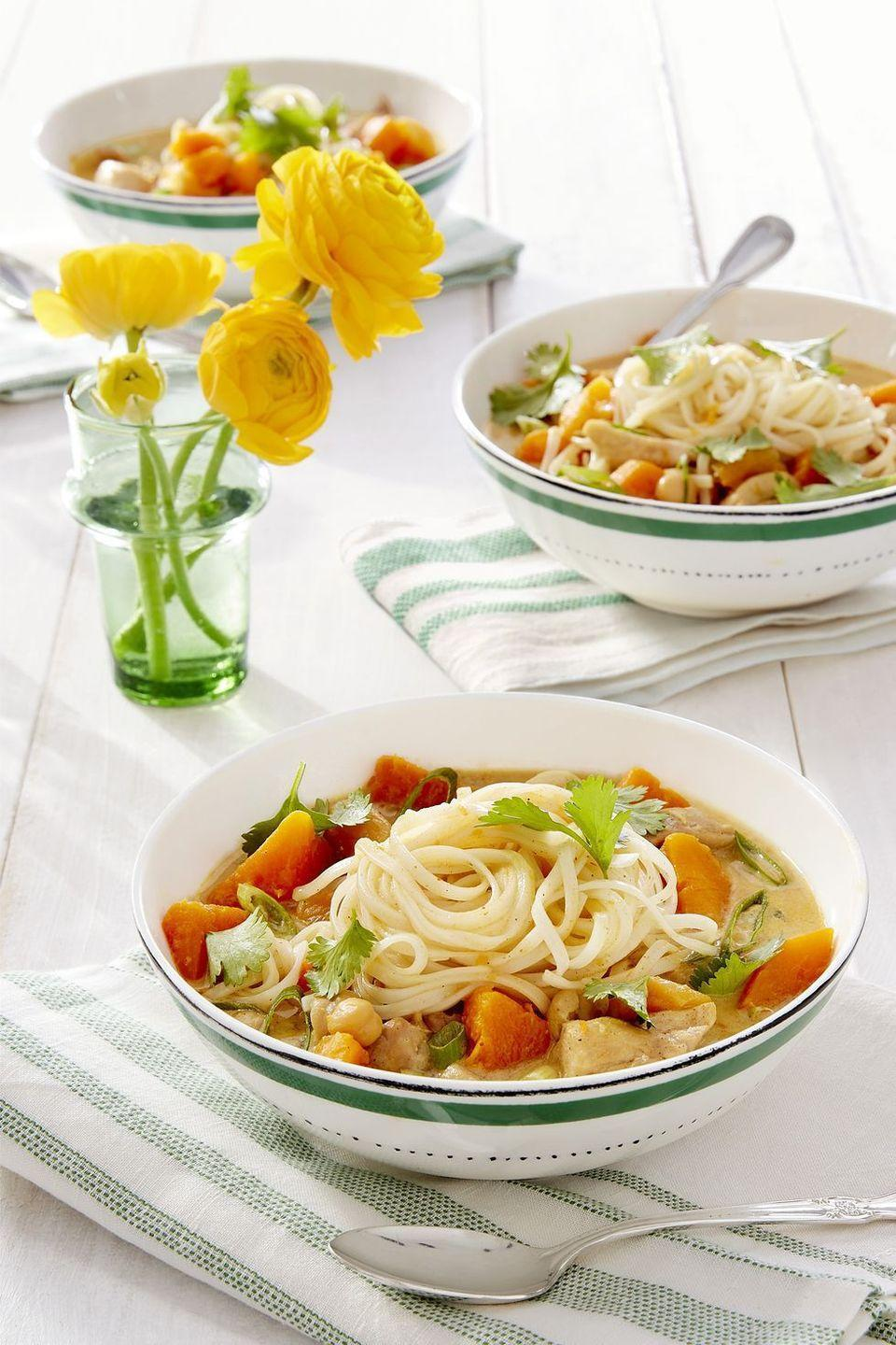 """<p>Instead of peeling and dicing, toss in pre-cut butternut squash for a hassle-free dinner. </p><p><a href=""""https://www.countryliving.com/food-drinks/a16571156/butternut-squash-apricot-chicken-noodle-curry-recipe/"""" rel=""""nofollow noopener"""" target=""""_blank"""" data-ylk=""""slk:Get the recipe from Country Living »"""" class=""""link rapid-noclick-resp""""><em>Get the recipe from Country Living »</em></a><br></p>"""