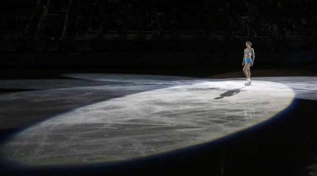 Italy's Carolina Kostner performs during the Figure Skating Gala Exhibition at the 2014 Sochi Winter Olympics February 22, 2014. REUTERS/Lucy Nicholson (RUSSIA - Tags: SPORT FIGURE SKATING OLYMPICS TPX IMAGES OF THE DAY)