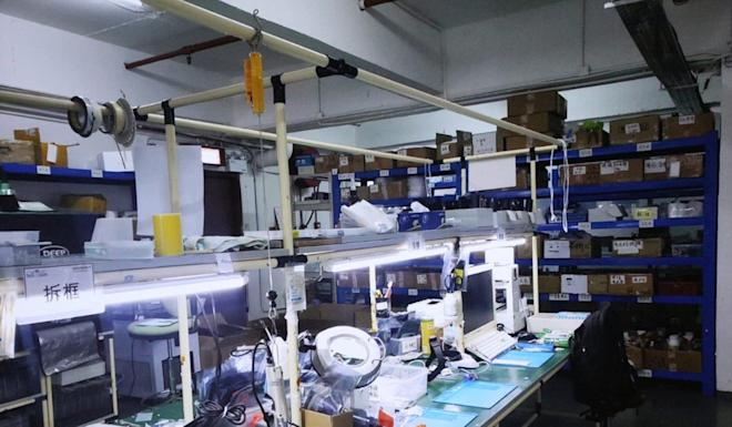 Customs raided the mobile phone workshop this week following a tip-off that it used fake parts. Photo: Handout