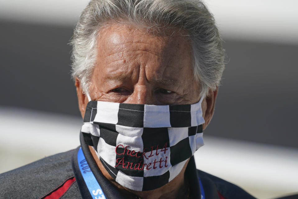 FILE - In this Aug. 21, 2020, file photo, Mario Andretti looks on before the final practice session for the Indianapolis 500 auto race at Indianapolis Motor Speedway. Andretti feels the same pain as so many others these days. His wife died two years ago, long before the pandemic. And his beloved nephew lost a brutal battle with colon cancer. But then COVID-19 claimed his twin brother and one of the greatest racers of all time is not immune from the loneliness and depression sweeping the world. (AP Photo/Darron Cummings, File)
