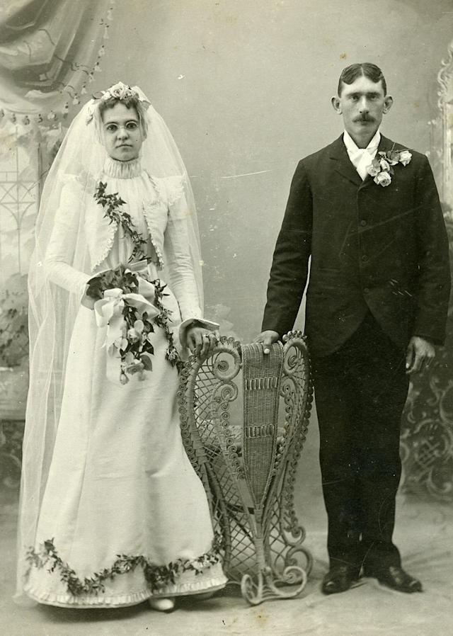"<p>Their nuptial portrait — first a painting and then a photograph in which the couple re-created the day, 14 years later — popularized the iconography among non-royals and the general worldwide population, becoming more commonplace in the late 1800s. (Pictured: Vintage wedding portraits from ""I Do, I Do"" exhibit) </p>"