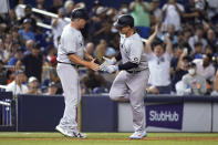 New York Yankees' Anthony Rizzo, right, is met by third base coach Phil Nevin after hitting a solo home run during the sixth inning of the team's baseball game against the Miami Marlins, Friday, July 30, 2021, in Miami. (AP Photo/Lynne Sladky)