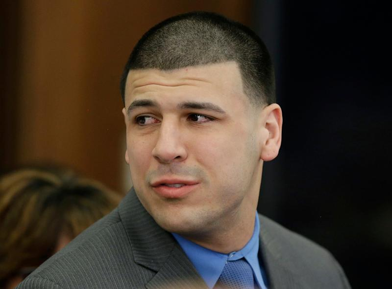 Former New England Patriots star Aaron Hernandez turns to look toward his fiancee Shayanna Jenkins Hernandez as he reacts to his double murder acquittal - Stephan Savoia/AP