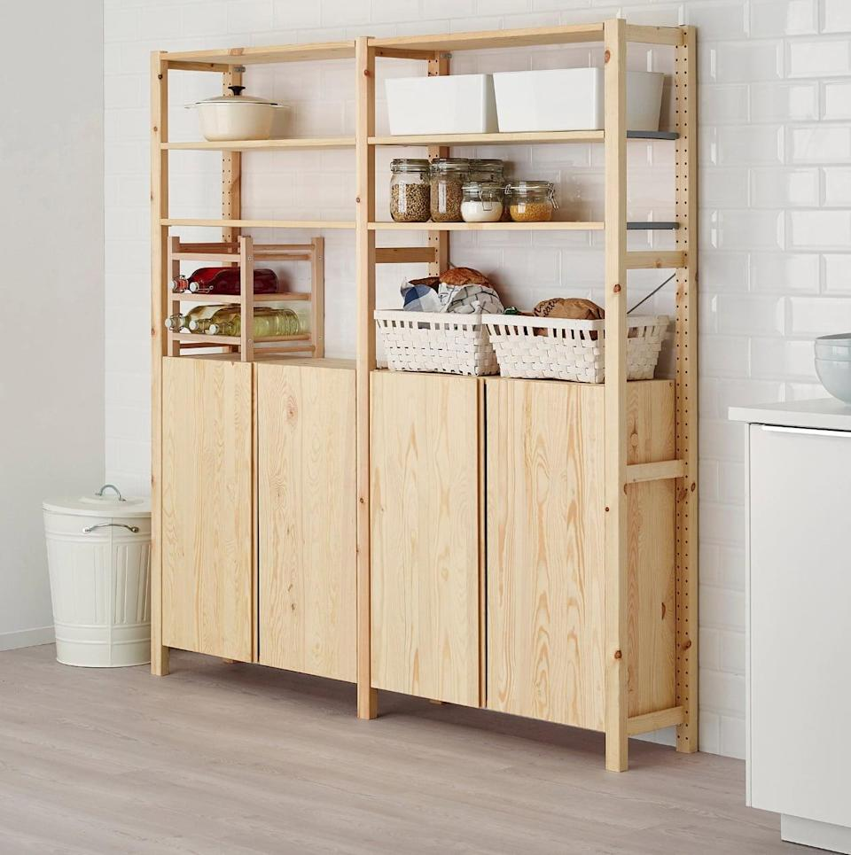 "<p>The natural finish on the <a href=""https://www.popsugar.com/buy/Ivar%202-Section%20Shelving%20Unit%20With%20Cabinet-447014?p_name=Ivar%202-Section%20Shelving%20Unit%20With%20Cabinet&retailer=ikea.com&price=223&evar1=casa%3Aus&evar9=46151613&evar98=https%3A%2F%2Fwww.popsugar.com%2Fhome%2Fphoto-gallery%2F46151613%2Fimage%2F46152204%2FIvar-2-Section-Shelving-Unit-Cabinet&list1=shopping%2Cikea%2Corganization%2Ckitchens%2Chome%20shopping&prop13=api&pdata=1"" rel=""nofollow noopener"" target=""_blank"" data-ylk=""slk:Ivar 2-Section Shelving Unit With Cabinet"" class=""link rapid-noclick-resp"">Ivar 2-Section Shelving Unit With Cabinet</a> ($223) makes this piece look striking in any kitchen space. Use the outer shelves to hold fresh produce and dishware, and use the closed cabinets to hold boxed food and other items.</p>"