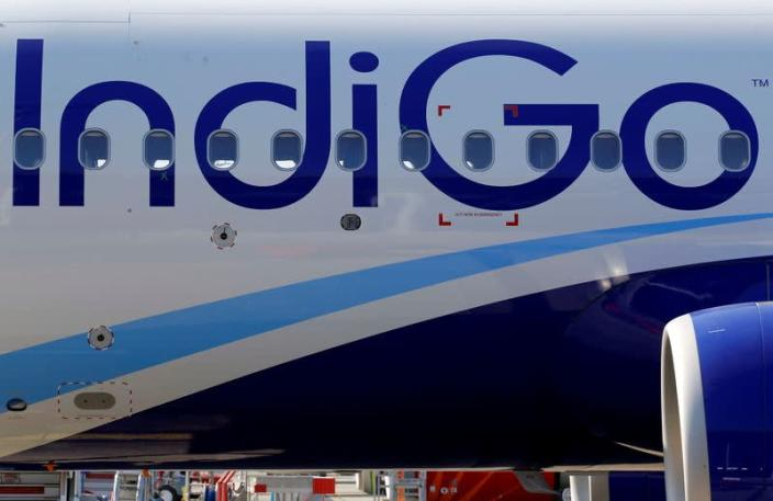 FILE PHOTO: The logo of IndiGo Airlines is pictured on passenger aircraft on the tarmac in Colomiers near Toulouse
