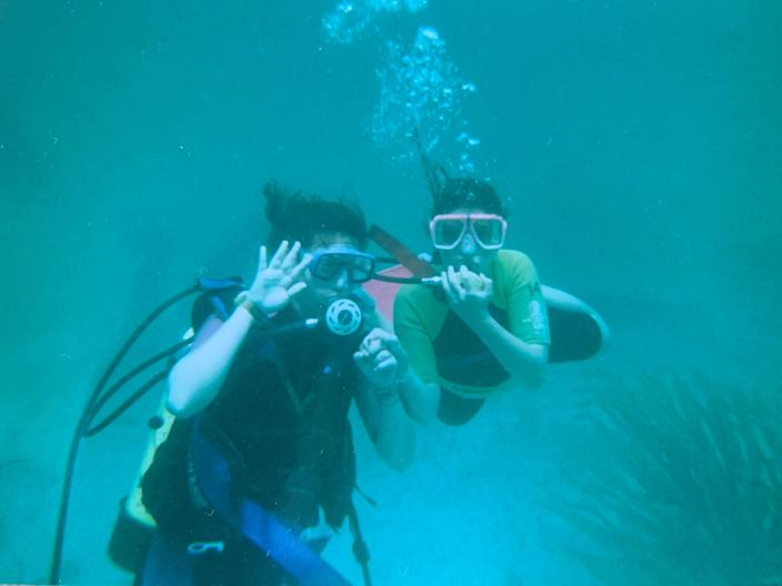 True buddies: Kari Colmans and her sister Lianna during a childhood scuba dive