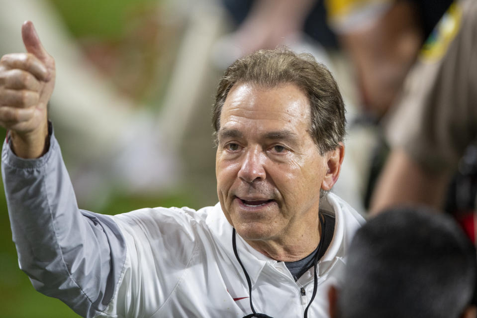 MIAMI GARDENS, FL - JANUARY 11: Alabama Crimson Tide head coach Nick Saban smiles and gives a thumbs up to the fans in the stands after the Alabama Crimson Tide defeated the Ohio State Buckeyes at the College Football Playoff National Championship football on January 11, 2021 at the Hard Rock Stadium in Miami Gardens, FL. (Photo by Doug Murray/Icon Sportswire via Getty Images)