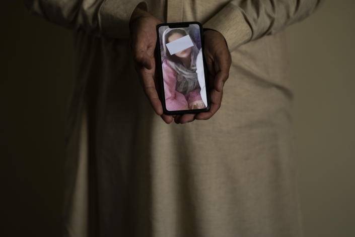 A picture, partially covering the identity of Popal's sister, is shown on a cell phone in Kabul, Afghanistan, Sunday, Sept. 26, 2021. The sisters went missing as she commuted between Kabul and Logar, and has not been heard from in weeks. The family fears it could be connected to warnings they received from relatives to stop the daughters from studies, Popal told the AP. (AP Photo/Bernat Armangue)