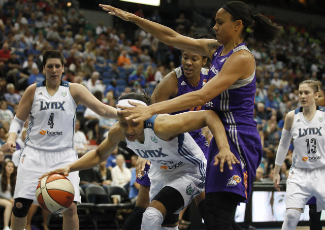 Minnesota Lynx guard Maya Moore (23) protects the ball as she works inside against Phoenix Mercury forward Candice Dupree (4) during the first half of a WNBA basketball game, Wednesday, July 24, 2013, in Minneapolis. (AP Photo/Stacy Bengs)