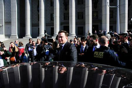 FILE PHOTO: Tesla Inc CEO Elon Musk (C) exits after attending a SEC. hearing at the Manhattan Federal Courthouse in New York, April 4, 2019.  REUTERS/Eduardo Munoz/File Photo