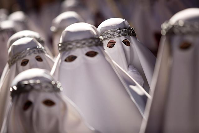 <p>Penitents take part in the procession of los Gitanos brotherhood during Holy Week on March 26, 2018 in Malaga, Spain. (Photo: Daniel Perez Garcia-Santos/Getty Images) </p>