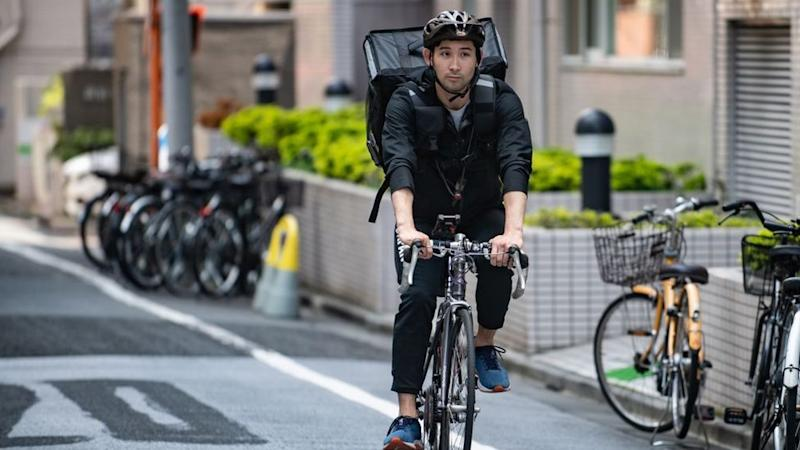 With the Olympics postponed, top Japanese fencer Ryo Miyake has swapped his mask and foil for a bike and backpack as a Tokyo UberEats delivery rider