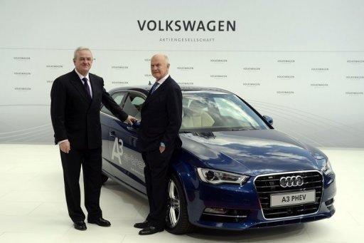 CEO Martin Winterkorn (left) and chairman Ferdinand Piech with an Audi A3 electric car at the Volkswagen plant in Wolfsburg on Monday. VW's results beat analysts' expectations, driving VW shares 5.6 percent higher on the Frankfurt stock exchange to 133.25 euros