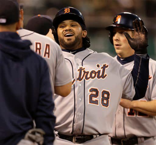 Detroit Tigers' Prince Fielder (28) celebrates after hitting a three-run home run off Oakland Athletics' Bartolo Colon in the third inning of a baseball game on Friday, April 12, 2013, in Oakland, Calif. (AP Photo/Ben Margot)