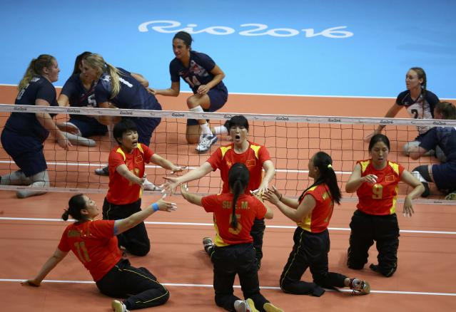 2016 Rio Paralympics - Sitting Volleyball - Final - Women's Gold Medal Match - Riocentro Pavilion 6 - Rio de Janeiro, Brazil, 17/09/2016. Players of team China celebrate. REUTERS/Pilar Olivares FOR EDITORIAL USE ONLY. NOT FOR SALE FOR MARKETING OR ADVERTISING CAMPAIGNS.
