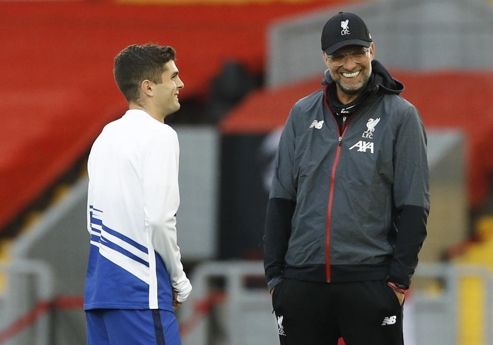 Liverpool manager Jurgen Klopp (right) gave Christian Pulisic his first major opportunities at Borussia Dortmund. (Pool via REUTERS/Phil Noble)