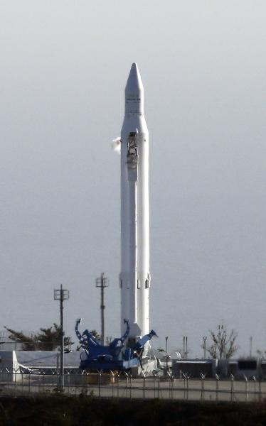 The Korea Space Launch Vehicle-1 sits on its launch pad at the Naro Space Center in Goheung, South Korea, Thursday, Nov. 29, 2012. South Korea on Thursday scrapped an attempt to fire its first satellite into orbit from its own soil amid speculation that North Korea was preparing to fire its own long-range rocket. (AP Photo/Yonhap, Lee Sang-hack) KOREA OUT