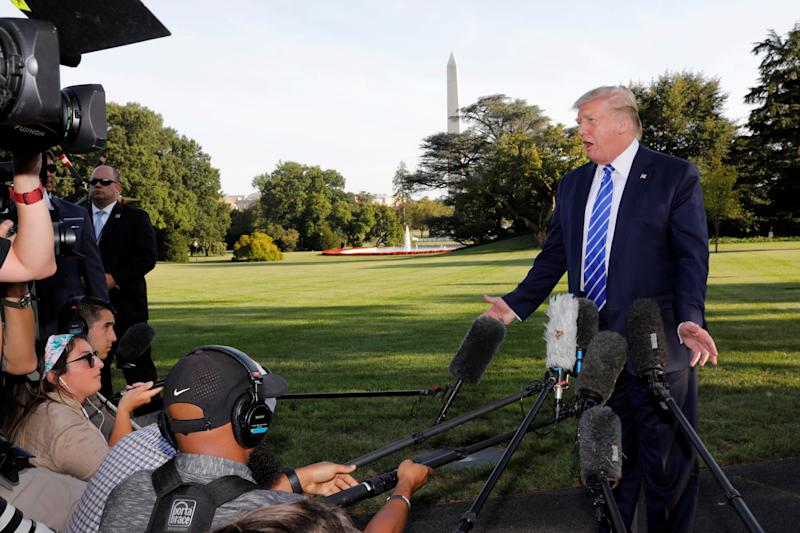 U.S. President Donald Trump speaks with reporters on the South Lawn of the White House in Washington, U.S., before his departure to Camp David, August 30, 2019. REUTERS/Yuri Gripas