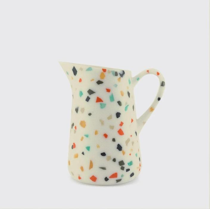 """Also available at Utilitario Mexicano, this delightfully speckled resin pitcher with angled spout is perfectly adorable, but should be hand-washed–resin and dishwashers don't always work well together. $101, Utilitario Mexicano. <a href=""""https://utilitariomexicano.com/products/10010013002?_pos=2&_sid=ba217638d&_ss=r"""" rel=""""nofollow noopener"""" target=""""_blank"""" data-ylk=""""slk:Get it now!"""" class=""""link rapid-noclick-resp"""">Get it now!</a>"""