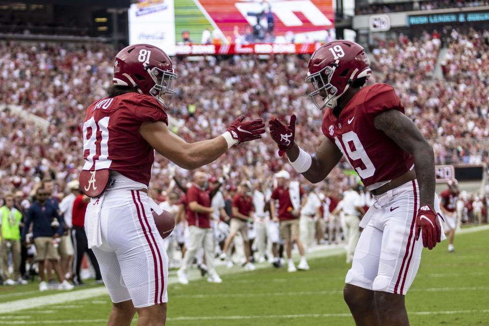 Alabama tight end Cameron Latu (81) celebrates his touchdown with tight end Jahleel Billingsley (19) during the first half of an NCAA college football game against Mississippi, Saturday, Oct. 2, 2021, in Tuscaloosa, Ala. (AP Photo/Vasha Hunt)
