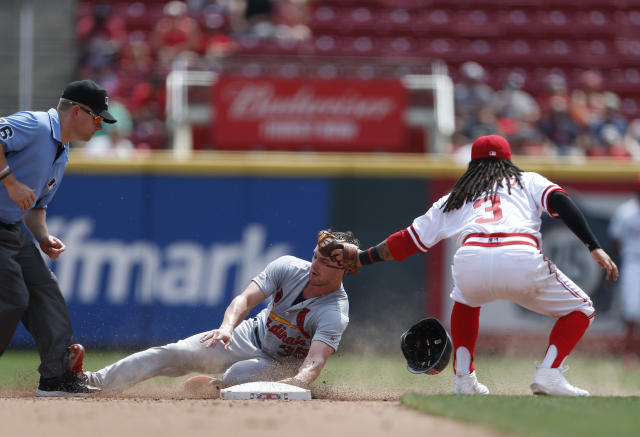 St. Louis Cardinals' Lane Thomas, center, is tagged out by Cincinnati Reds second baseman Freddy Galvis (3) on a steal-attempt during the fourth inning of a baseball game, Sunday, Aug. 18, 2019, in Cincinnati. (AP Photo/Gary Landers)