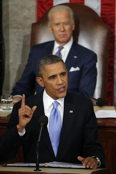 Vice President Joe Biden listens as President Barack Obama gives his State of the Union address on Capitol Hill in Washington, Tuesday Jan. 28, 2014. (AP Photo/Charles Dharapak)