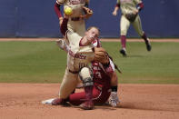 Florida State's Josie Muffley (10) forces out Oklahoma's Grace Lyons (3) at second base in the second inning of the final game of the NCAA Women's College World Series softball championship series Thursday, June 10, 2021, in Oklahoma City. (AP Photo/Sue Ogrocki)