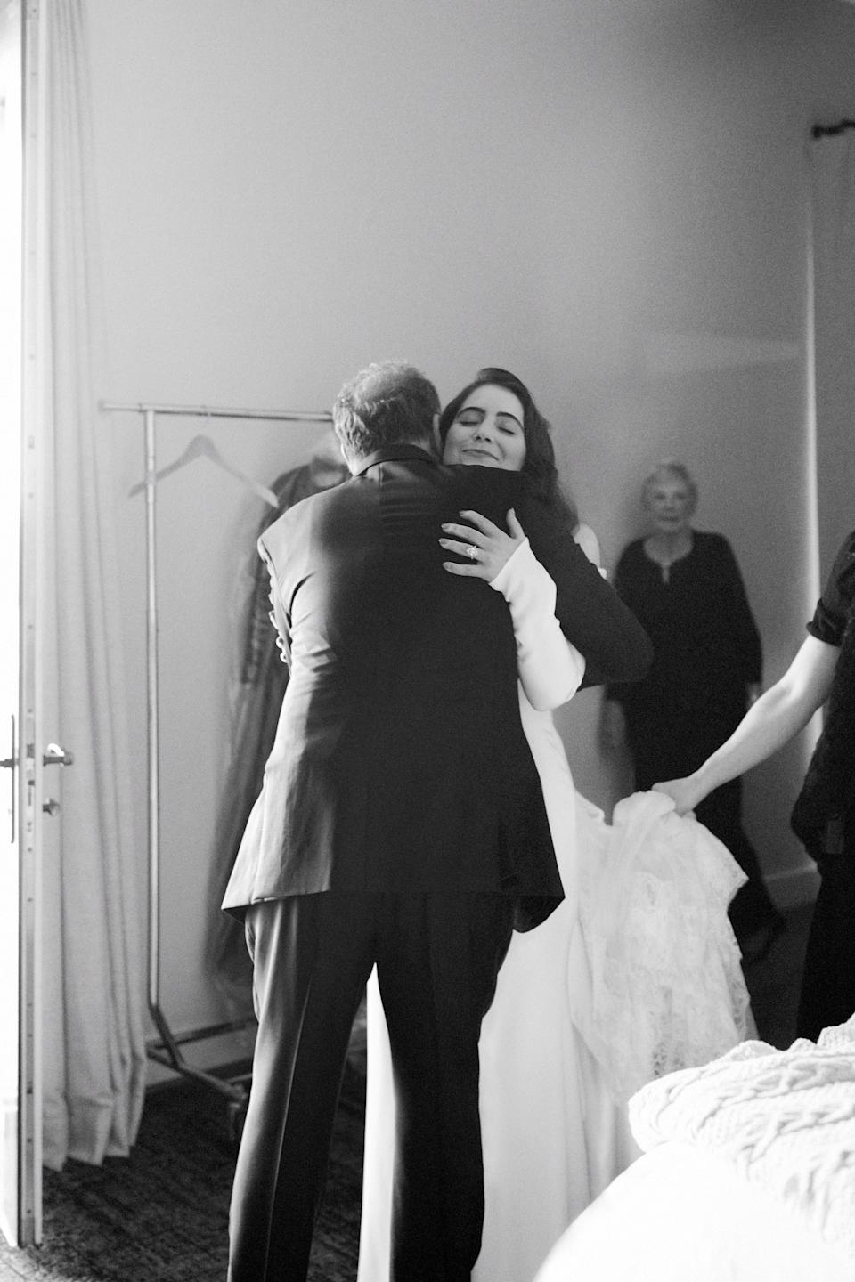 My sweet father and I hugging before we walked down the aisle. My dad and I have a special bond and share many similarities. He is my mentor and dearest confidante. No wonder I chose to become a dentist, just like him.