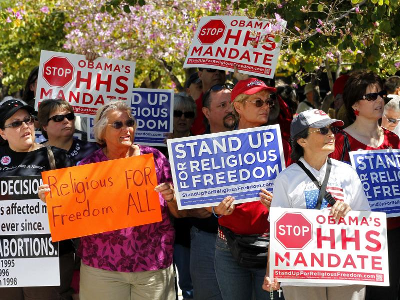 Protesters stand outside the Sandra Day O'Connor Federal Courthouse  Friday, March 23, 2012 in Phoenix. during the Stand Up For Religious Freedom Rally. The rally is part of a nationwide Rally for Religious Freedom which is a reaction against the Obama Administration's HHS mandate that will obligate Catholic organizations to provide contraceptive services to their employees. (AP Photo/Matt York)