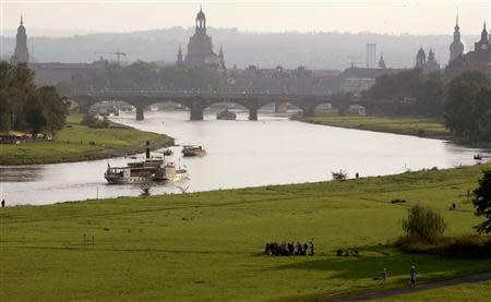 A general view shows a vintage steamboat sailing down the Elbe river, where the planned 'Waldschloesschenbruecke' bridge should cross the river, in front of the historic city centre of the eastern German city of Dresden in this August 27, 2006 file photo. REUTERS/Arnd Wiegmann/Files