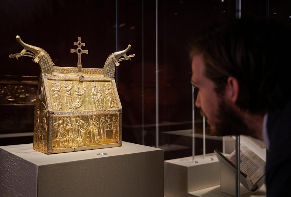 a copper reliquary showing the execution