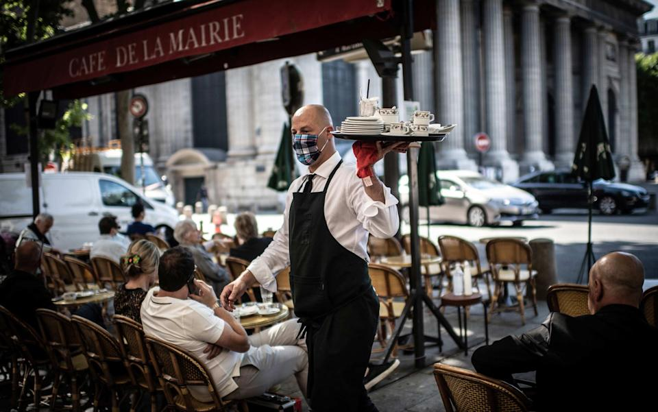 Waiters will wear face masks for the forseeable - AFP