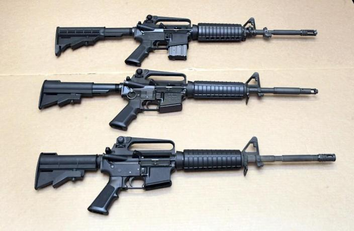 FILE - In this Aug. 15, 2012 file photo, three variations of the AR-15 rifle are displayed at the California Department of Justice in Sacramento, Calif. On Sept. 19, 2019, Connecticut-based Colt Firearms said it was suspending production of its version of the AR-15 for the civilian market. (AP Photo/Rich Pedroncelli, File)