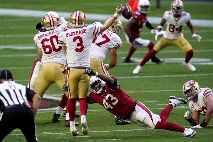 Arizona Cardinals outside linebacker Haason Reddick (43) forces San Francisco 49ers quarterback C.J. Beathard (3) to fumble the ball during the first half of an NFL football game, Saturday, Dec. 26, 2020, in Glendale, Ariz. The Cardinals recovered the ball. (AP Photo/Ross D. Franklin)