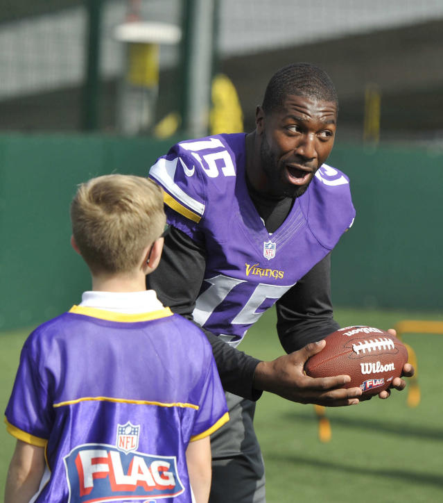 Greg Jennings of the Vikings takes part in a coaching clinic for London children near Wembley Stadium, London, Tuesday Sept. 24, 2013. The Pittsburgh Steelers are to play the Minnesota Vikings in the NFL International Series at Wembley Stadium in London on Sunday, Sept 29. (AP Photo/Sean Ryan, NFL)