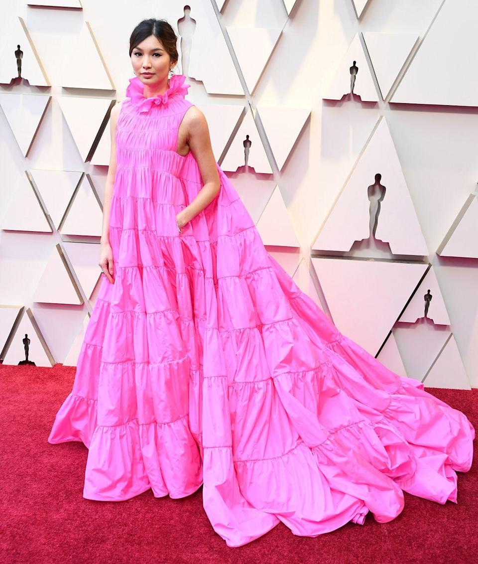 <p>Gemma Chan in Valentino. Yes, she made the most of those pockets by bringing snacks with her. And yes—there is <span>video of it</span>.</p>