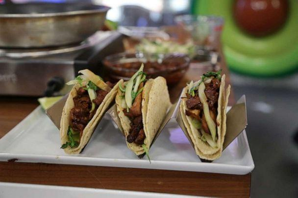 PHOTO: Chef Jordan Andino shares his recipe for hard tacos stuffed with sauteed bok choy and topped with chicken adobo. (ABC)